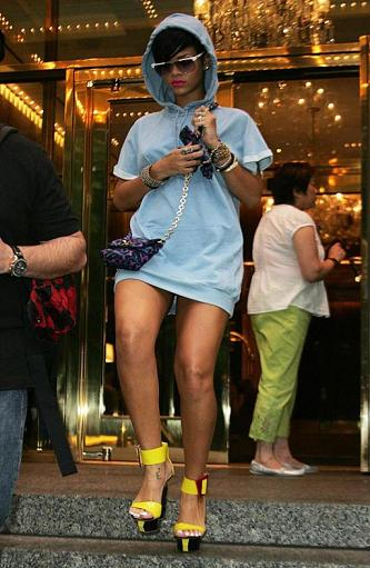 Rihanna's yellow heels are fabulous. Her hoodie and no pants look? Even more fabulous.  Photo Credit: Fame Pictures