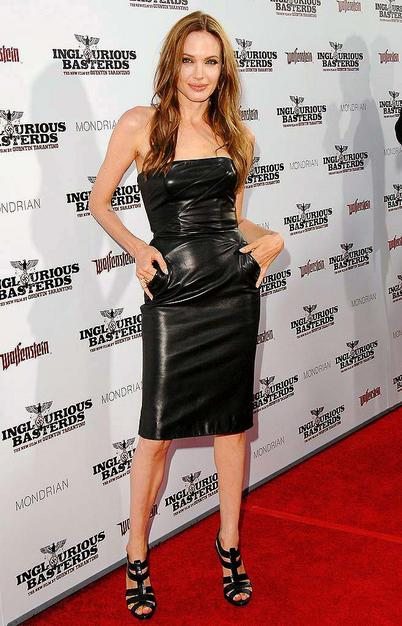 """Angelina Jolie has been MIA on the red carpet recently, but the A-list actress made a triumphant return at the premiere of her man Brad Pitt's latest film, """"Inglourious Basterds,"""" in a black strapless leather dress courtesy of Michael Kors."""