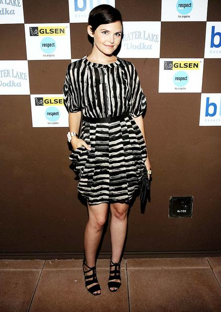 "Despite the fact that Ginnifer Goodwin always seems to suppress her smile, the ""Big Love"" star looked quite lovely in a striped bubble dress at a charity event in Beverly Hills"