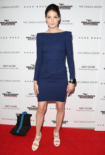 """Eagle Eye"" star Michelle Monaghan, who paired a structured navy Rachel Roy dress with a chunky cuff and Manolo Blahnik strappy sandals."