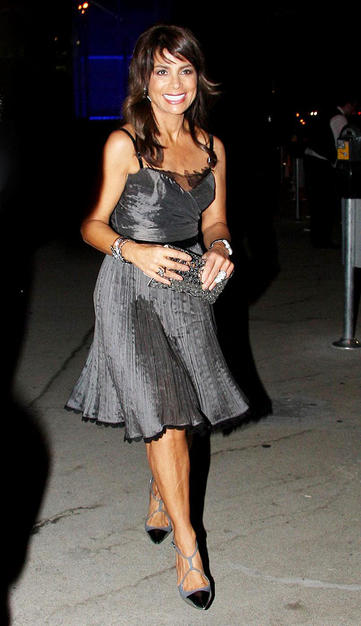 "With all the ""Idol"" drama still swirling, it was nice to see Paula Abdul with a smile on her face as she headed to dinner at BOA in LA in a flirty silver frock and fierce footwear."