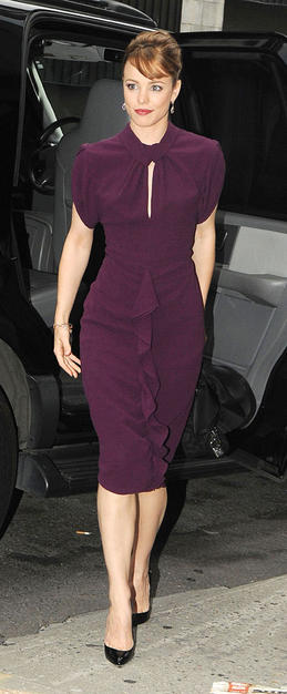 """""""Time Traveler's Wife"""" star Rachel McAdams looked like a member of the """"Mad Men"""" cast as she made her way to a taping of """"The Daily Show With Jon Stewart"""" in a classy plum dress, black pumps, chandelier earrings, and updo."""