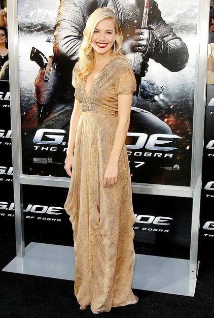"Sienna Miller channeled Old Hollywood at a ""G.I. Joe: Rise of the Cobra"" screening in a glamorous gold Yves St. Laurent gown, cherry red lips, and wavy 'do."
