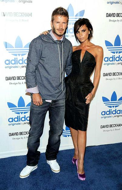 David Beckham and his posh wife Victoria (in a William Tempest LBD) arrive at a launch party for the soccer stud's new sportswear line at the Adidas flagship store on Melrose Avenue in Los Angeles.